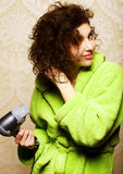 Woman drying her hair with hairdryer Royalty Free Stock Photo
