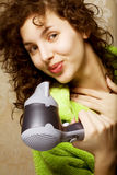 Woman drying her hair with hairdryer. Beautiful woman drying her hair with hairdryer Stock Photos
