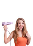 Woman drying her hair with hairdryer. Beautiful woman drying her hair with hairdryer Stock Photography