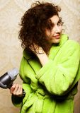 Woman drying her hair with hairdryer. Beautiful woman drying her hair with hairdryerrr Royalty Free Stock Image