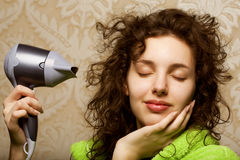 Woman drying her hair with hairdryer. Beautiful woman drying her hair with hairdryerrr Stock Photo