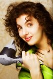 Woman drying her hair with hairdryer. Beautiful woman drying her hair with hairdryerrr Royalty Free Stock Images