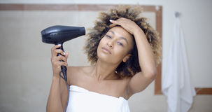 Woman Drying Her Hair With Hairdryer Stock Image