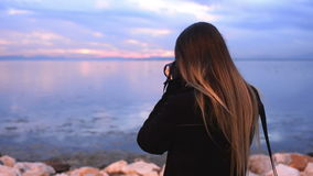 Woman with dslr camera. stock footage