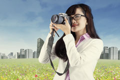 Woman with DSLR camera 1 Stock Photography
