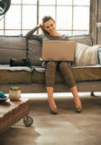 Woman with dslr photo camera using laptop Stock Image