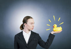Woman with duck toy Stock Photos