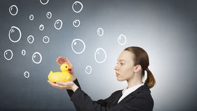 Woman with duck toy Stock Photo