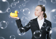 Woman with duck toy Stock Photography