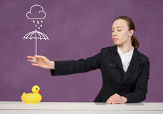 Woman with duck toy Royalty Free Stock Image