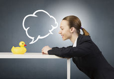 Woman with duck toy Royalty Free Stock Images