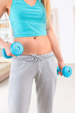 Woman with dumb bells Royalty Free Stock Image