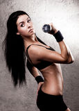 Woman with a dumbbell Royalty Free Stock Images