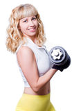 Woman with a dumbbell Royalty Free Stock Photos