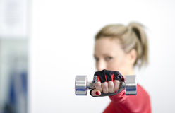 Woman with dumbbell Stock Images