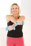 Woman with dumbbell Royalty Free Stock Photos