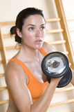 Woman with dumbbell, close-up Stock Image