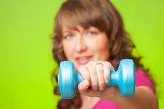 Woman with dumbbell Royalty Free Stock Image
