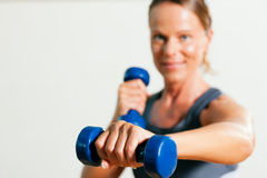 Woman with dumbbell in gym Royalty Free Stock Images