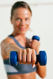 Woman with dumbbell in gym Royalty Free Stock Image