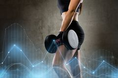 Woman with dumbbell in gym Stock Photography