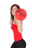 Woman with dumbbell in hand Stock Images