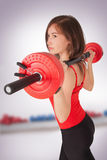 Woman with dumbbell in hand Stock Image