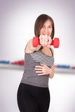 Woman with dumbbell in hand Royalty Free Stock Image