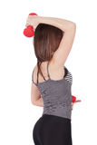 Woman with dumbbell in hand Stock Photos