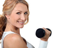 Woman with dumbbell Stock Photo