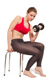 Woman with dumbbell. Pretty woman with dumbbell isolated on white background Royalty Free Stock Photography