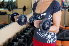 Woman with dumbbell Stock Image