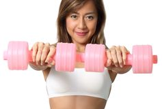 Woman and dumbbell Royalty Free Stock Image