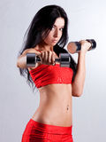 Woman with dumbbells Royalty Free Stock Photography