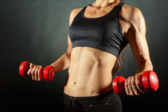 Woman with dumbbells Stock Images