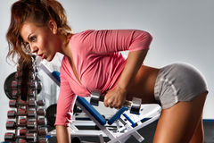 Woman with dumbbells Stock Photo