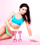 Woman with dumbbells Stock Photos