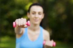Woman with dumbbells Royalty Free Stock Photo
