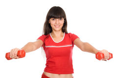Woman with dumbbells at arm's length Royalty Free Stock Images