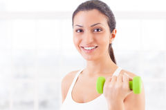 Woman with dumbbells. Royalty Free Stock Photography