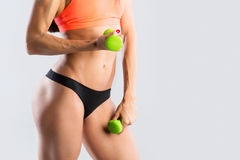 Woman with dumbbells doing exercises. Stock Photos