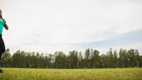 Woman With Dumbbells in a Meadow stock footage