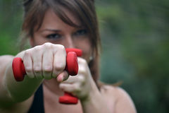 Woman with dumbbells in the park Stock Image