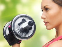 Woman with dumbbells Royalty Free Stock Images