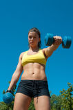 Woman with dumbbells on playground Royalty Free Stock Images