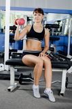 Woman with dumbbells in sports club Stock Photo