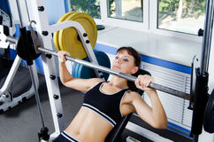 Woman with dumbbells in sports club Royalty Free Stock Photos