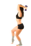 Woman with  dumbbells workout in gym Stock Photos