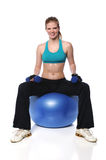 Woman With Dumbells and Exercise Ball Royalty Free Stock Photos