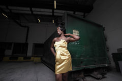 Woman by a dumpster Stock Photography